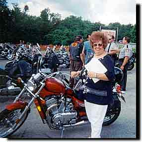 Carolyn collecting names in Penn from the motorcycles in Uniontown